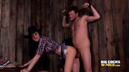 Naughty cowgirl with big tits fucks her tied up slave